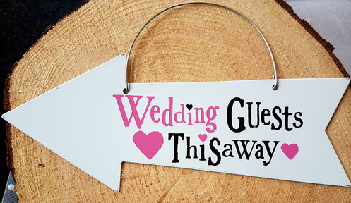 Wedding guest this away sign
