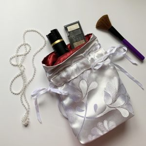 Emergency Kit pouch in white and rich luxury red atin fabric